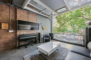 One of a Kind East Village Triplex With Retractable Walls and Massive Garden